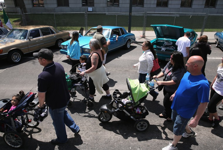 People view a row of low riders on display at a Cinco de Mayo festival in Denver, Colorado. (John Moore/Getty Images)