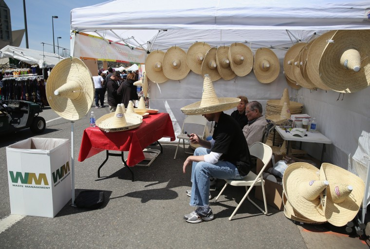 Sombeero sombreros, which hold 32 ounces of liquid, await sale at a Cinco de Mayo festival celebrating Mexican culture in Denver, Colorado. (John Moore/Getty Images)