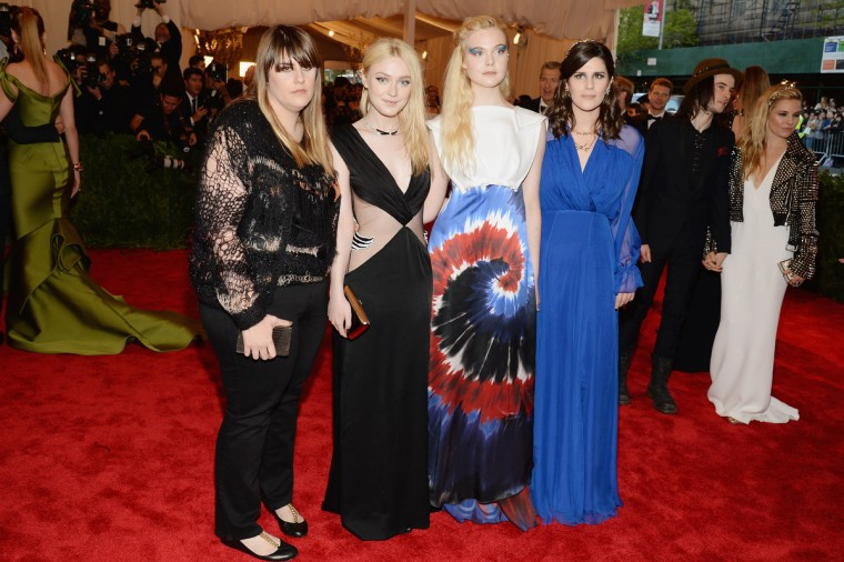 "Kate Mulleavy, Dakota Fanning, Elle Fanning and Laura Mulleavy attend the Costume Institute Gala for the ""PUNK: Chaos to Couture"" exhibition at the Metropolitan Museum of Art on May 6, 2013 in New York City. (Dimitrios Kambouris/Getty Images)"