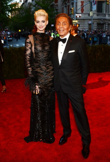 "Actress Anne Hathaway (L) and designer Valentino Garavani attends the Costume Institute Gala for the ""PUNK: Chaos to Couture"" exhibition at the Metropolitan Museum of Art on May 6, 2013 in New York City. (Larry Busacca/Getty Images)"