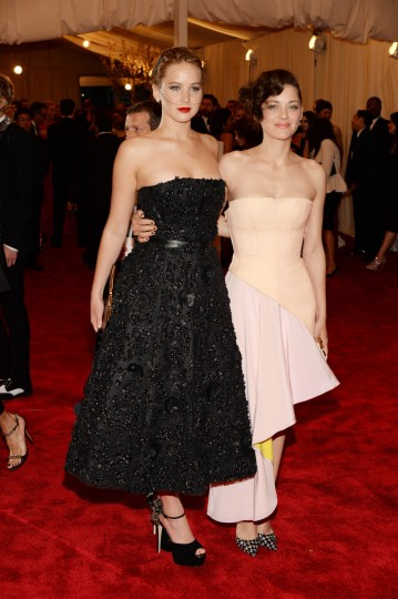 "Actors Jennifer Lawrence (L) and Marion Cotillard attend the Costume Institute Gala for the ""PUNK: Chaos to Couture"" exhibition at the Metropolitan Museum of Art on May 6, 2013 in New York City. (Dimitrios Kambouris/Getty Images)"