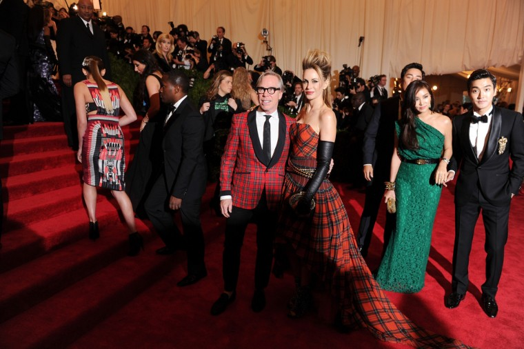 "Tommy Hilfiger and Dee Hilfiger attend the Costume Institute Gala for the ""PUNK: Chaos to Couture"" exhibition at the Metropolitan Museum of Art on May 6, 2013 in New York City. (Dimitrios Kambouris/Getty Images)"