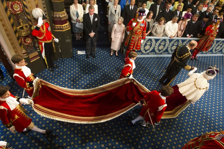 Prince Philip, Duke of Edinburgh and Queen Elizabeth II arrive for the state opening of Parliament at the House of Lords in London, England. Queen Elizabeth II will unveil the coalition government's legislative program in a speech delivered to Members of Parliament and Peers in The House of Lords. Proposed legislation is expected to be introduced on toughening immigration regulations, capping social care costs in England and setting a single state pension rate of 144 GBP per week. (Lewis Whyld - WPA Pool/Getty Images)