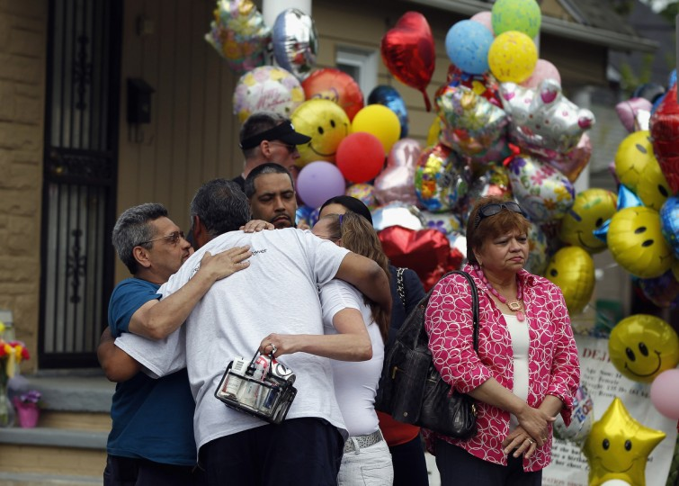 The father of kidnapping victim Gina DeJesus, Felix DeJesus (2L), hugs family members outside of their home during his daughter's homecoming in Cleveland, Ohio. Gina DeJesus was one of three women who were held captive for almost a decade in a home in Cleveland, Ohio. Amanda Berry, Gina DeJesus, and Michelle Knight managed to escape their captors on May 6, 2013. Three suspects, brothers Ariel, Pedro and Onil Castro, were taken into custody in connection with the crime. (Matt Sullivan/Getty Images)