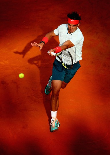 Rafael Nadal of Spain in action during his third round match against Ernests Gulbis of Latvia on day five of the Internazionali BNL d'Italia 2013 at the Foro Italico Tennis Centre in Rome, Italy. (Clive Mason/Getty Images)
