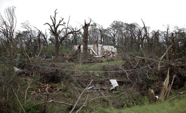 A home sits damaged after a tornado moved through the area May 20, 2013 near Shawnee, Oklahoma. A series of tornados moved across central Oklahoma May 19, killing two people and injuring at least 21. (Brett Deering/Getty Images)