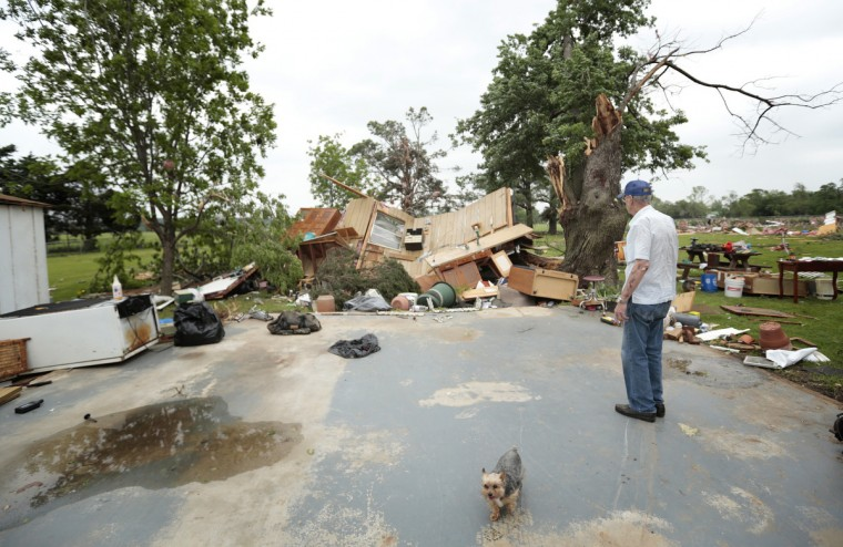 Lonnie Langston stands near his garage that was swept off the concrete pad next to his house by a tornado May 20, 2013 near Shawnee, Oklahoma. A series of tornados moved across central Oklahoma May 19, killing two people and injuring at least 21. (Brett Deering/Getty Images)