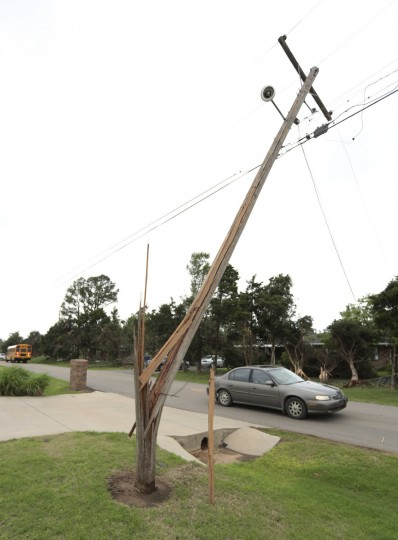 A power line pole bent by a tornado stands over a street May 20, 2013 near Shawnee, Oklahoma. A series of tornados moved across central Oklahoma May 19, killing two people and injuring at least 21. (Brett Deering/Getty Images)