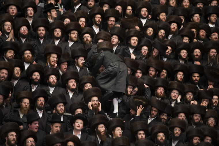 Tens of thousands of Ultra-Orthodox Jews of the Belz Hasidic Dynasty take part in the wedding ceremony of Rabbi Shalom Rokach, the Grandson of the Belz Rabbi to Hana Batya Pener. in Jerusalem, Israel. Some 25,000 Ultra-Orthodox Jews participated in one of the biggest weddings of the of Ultra-Orthodox Jewish community in the past few years. (Uriel Sinai/Getty Images)