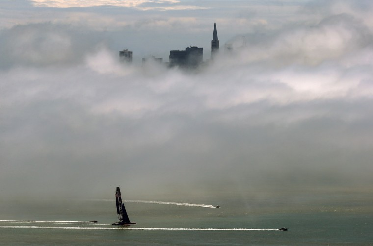 The Oracle AC72 America's Cup catamaran sails on the San Francisco Bay under a blanket of fog as seen from Sausalito, California. The San Francisco Bay Area will see mostly cloudy skies with highs expected to be in the 50s to mid 60s. (Justin Sullivan/Getty Images)
