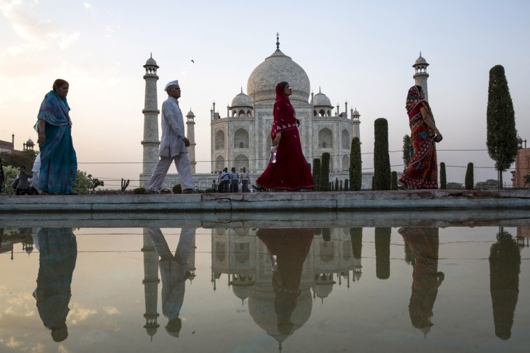 Indian and foreign tourists visit the Taj Mahal in Agra, India. Completed in 1643, the mausoleum was built by the Mughal emperor Shah Jahan in memory of his third wife, Mumtaz Mahal, who is buried there alongside Jahan. (Daniel Berehulak/Getty Images)