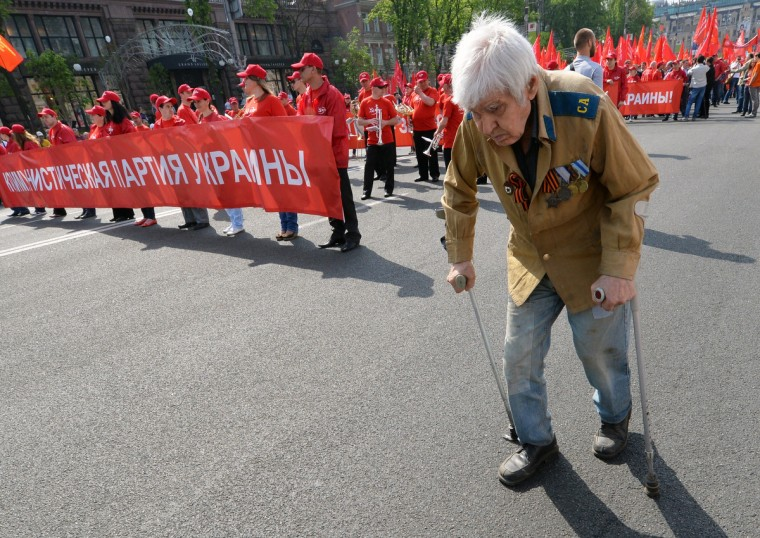 A veteran of World War II walks ahead the Ukrainian Communists march and rally marking May Day in the center of Kiev. (Sergei Supinsky/Getty Images)