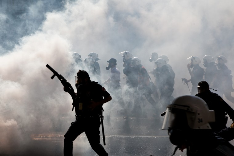 Police clash with protestors at a May Day demonstration in Istanbul. Turkish riot police used water cannon and tear gas on Wednesday in a bid to disperse hundreds of protesters who defied a Labour Day ban on demonstrations in a central part of Istanbul. The ban was imposed to avoid trouble during renovation work taking place at the symbolic Taksim square, a traditional rallying point. (Gurcan Ozturk/Getty Images)