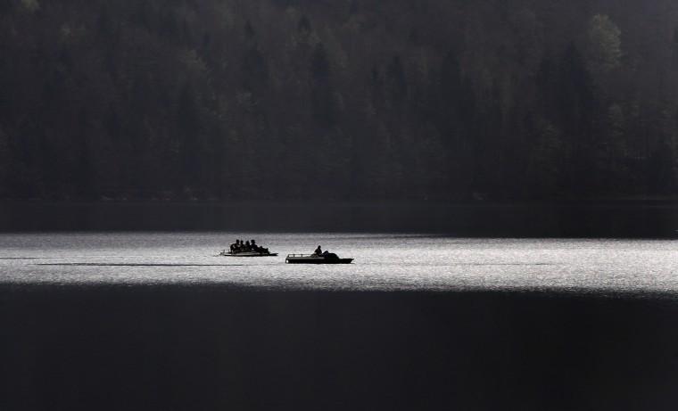 People take a cruise on the Alpsee lake near Hohenschwangau, southern Germany. (Karl-Josef Hildenbrand/Getty Images)