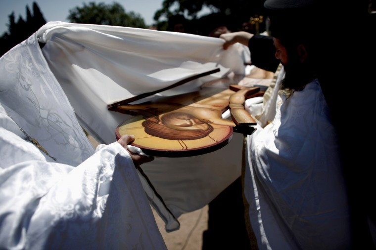 Greek Orthodox priests carry out the Apokathelosis, which forms a key part of Orthodox Easter, in a ceremony at the Church of the Dormition of the Virgin in Penteliin Penteli, north Athens, Greece. (Angelos Tzortzinis/Getty Images)