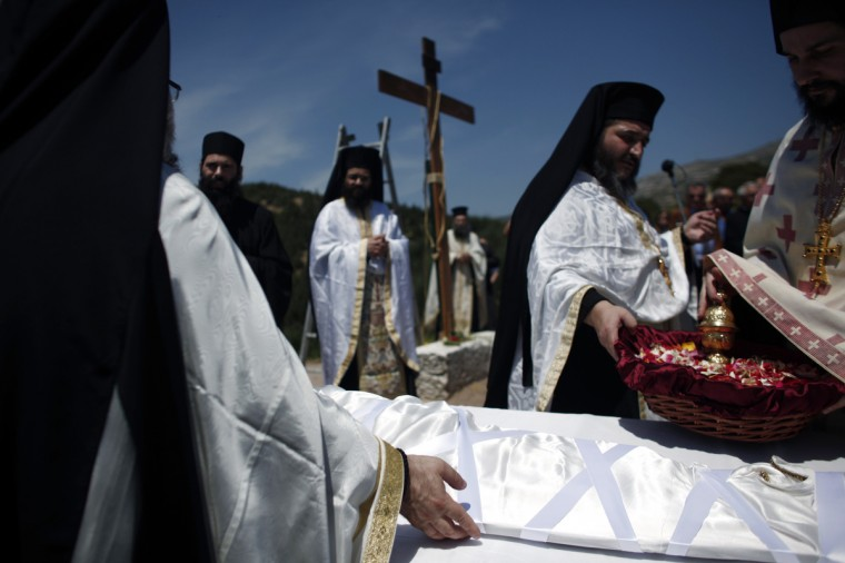 Greek Orthodox priests carry out the Apokathelosis, which forms a key part of Orthodox Easter, in a ceremony at the Church of the Dormition of the Virgin in Penteliin Penteli, north Athens. (Angelos Tzortzinis/Getty Images)