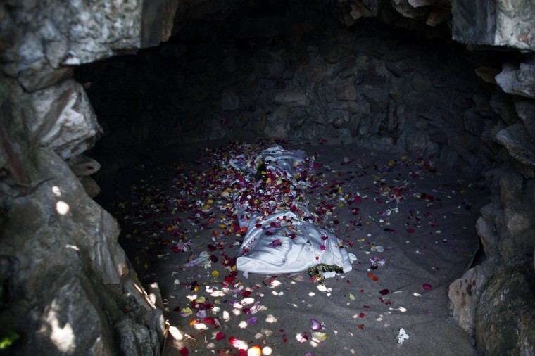 """The """"shrouded body of Jesus Christ"""" is seen at Its tomb after the end of the Apokathelosis, which forms a key part of Orthodox Easter. (Angelos Tzortzinis/Getty Images)"""