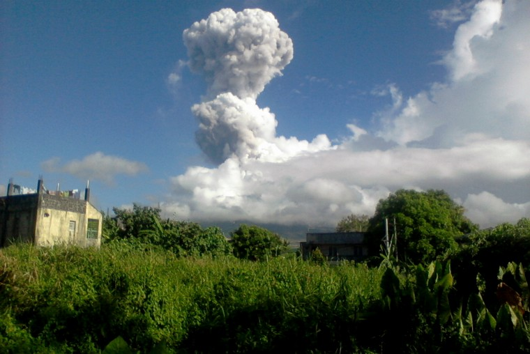 Volcano Mount Mayon spews a thick column of ash 500 metres (1,600 feet) into the air, as seen from the city of Legazpi, albay province, southeast of Manila. Five people are feared dead after one of the Philippines' most active volcanoes spewed a giant ash cloud, with foreign tourists on its slopes during the eruption, authorities said. (Phivolcs-Dost/AFP/Getty Images)