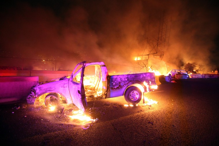 Burned cars are pictured in a highway in Ecatepec near Mexico city. A gas tanker exploded in a Mexico City suburb on Tuesday, killing at least 18 people and damaging several homes and cars, an official said. (Victor Rojas/AFP/Getty Images)