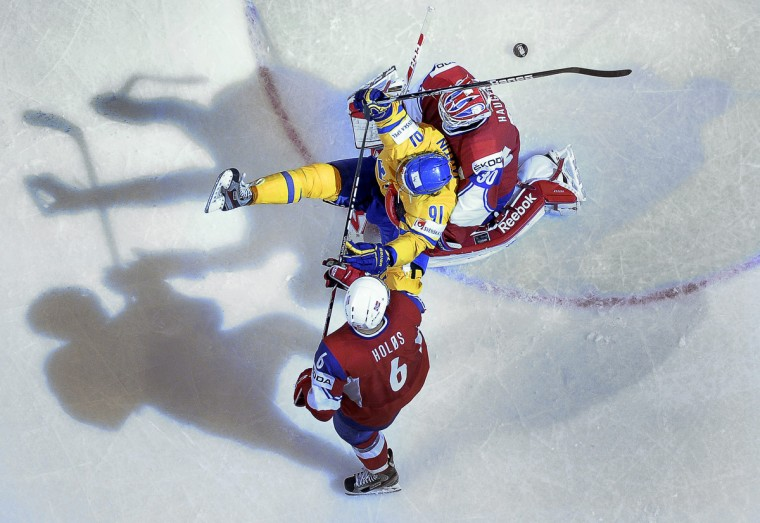 Sweden's Andreas Jamtin (C) scores past Norway's goalkeeper Lars Haugen (R) and Jonas Holos during the preliminary round match Norway vs Sweden at the 2013 IIHF Ice Hockey World Championships in Stockholm. Sweden won 5-1. (Anders Wiklund/Getty Images)
