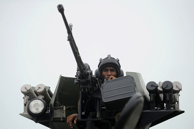 A Sri Lankan soldier looks on from his gun turret during a Victory Day parade rehearsal in Colombo. Sri Lanka celebrates War Heroes month with a military parade scheduled for May 18. The parade celebrates the fourth anniversary of the military defeat of the Tamil Tiger rebels in May 2009, ending a 37-year long separatist conflict. (Ishara S. Kokikara/Getty Images)