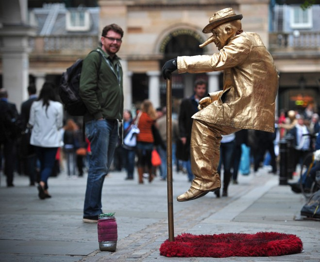 A street artist performs in Covent Garden in central London, 2013. (Carl Court/Getty Images)