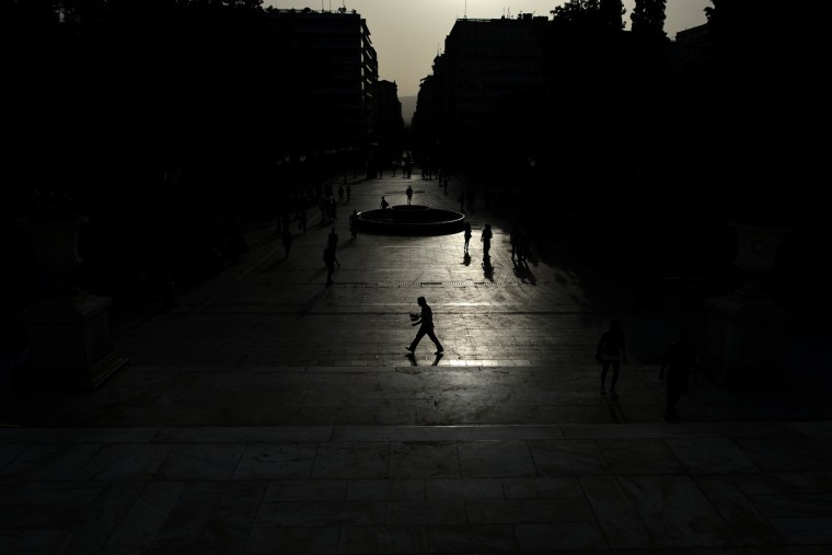 People walk at the Athens' main square of Syntagma. (Aris Messinis/Getty Images)