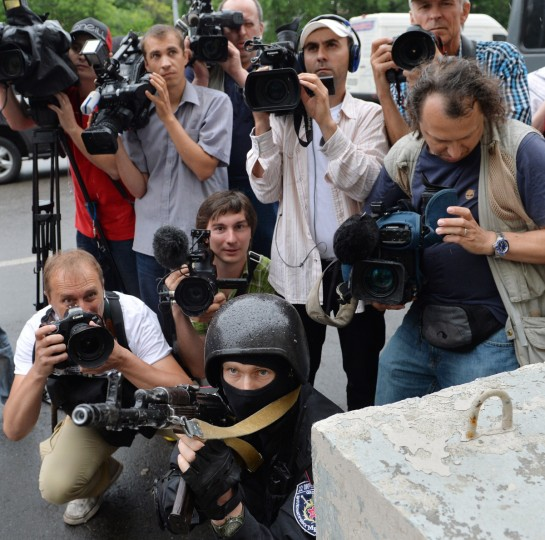 Ukrainian cameramen and photographers observe Ukrainian special forces officers taking part in an anti-terrorism exercise at the Israeli embassy in Kiev. The special forces' anti-terrorism drills were also conducted at Jewish schools, synagogues, and cultural centers in the Ukrainian capital. (Sergi Supinsky/Getty images)