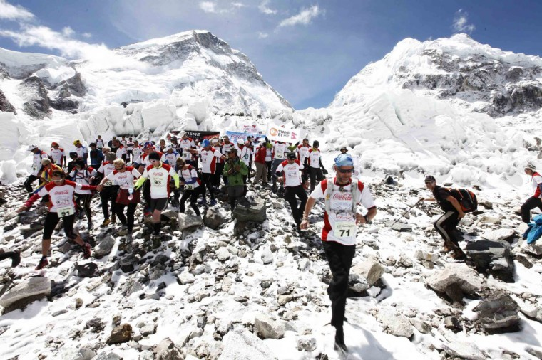 The Tenzing-Hillary Everest Marathon, the world's highest marathon, starts near the famous Khumbu Ice Fall at Qomolangma Base Camp (5,364 meters above sea level) and finishes at Namche Bazar (3,440 meters above sea level). Nepali athlete Ram Kumar Rajbhandari (31) clinched the title of the 11th Tenzing Hillary Everest Marathon, completing the 42.19 km race in 3 hour 59 minute 45 second on Wednesday as Nepali athletes continued their dominance in the highest altitude marathon claiming all top ten positions. (HIMEX-Tenzing-Hillary Everest Marathon/Getty Images)