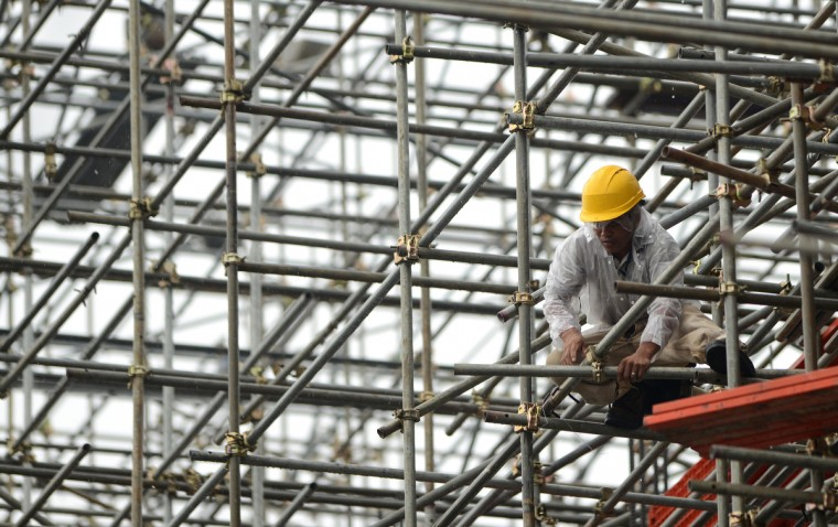 A worker is seen at a scaffolding at a construction site in Manila. The Philippine economy posted a surprising 7.8 percent growth in the first quarter of 2013, the best performance since President Benigno Aquino took office in 2010, officials said. (Noel Celis/Getty Images)