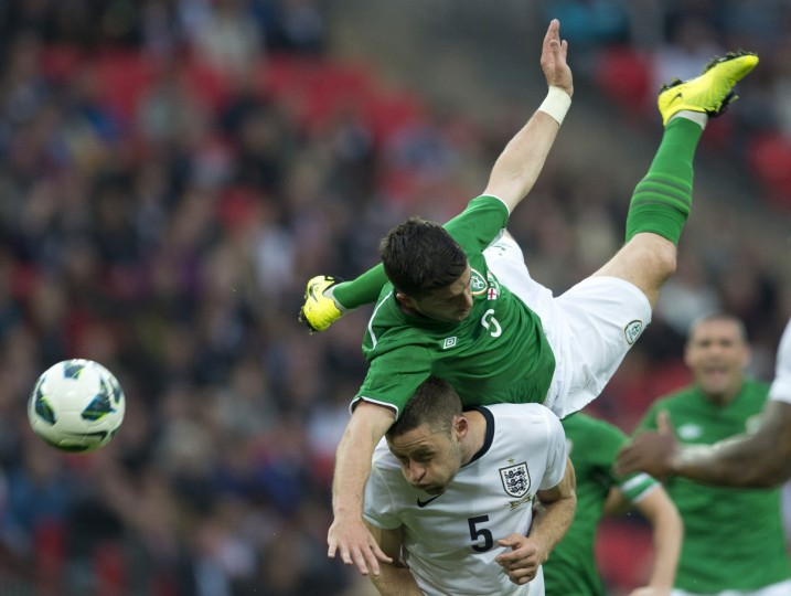 Republic of Ireland striker Shane Long tries to climb over England defender Gary Cahill during the international friendly football match between England and Republic of Ireland at Wembley Stadium in north London. (Adrian Dennis/Getty images)
