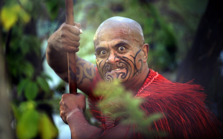 "A Maori in traditional clothing performs during the inauguration of the garden ""Te Putake"" dedicated to Maori culture in Les Jardins Fruitiers (fruit gardens) in Laquenexy, eastern France. The garden is the first outside of New Zealand to be dedicated to the Maori culture. (Jean-Christophe Verhaegen/Getty images)"