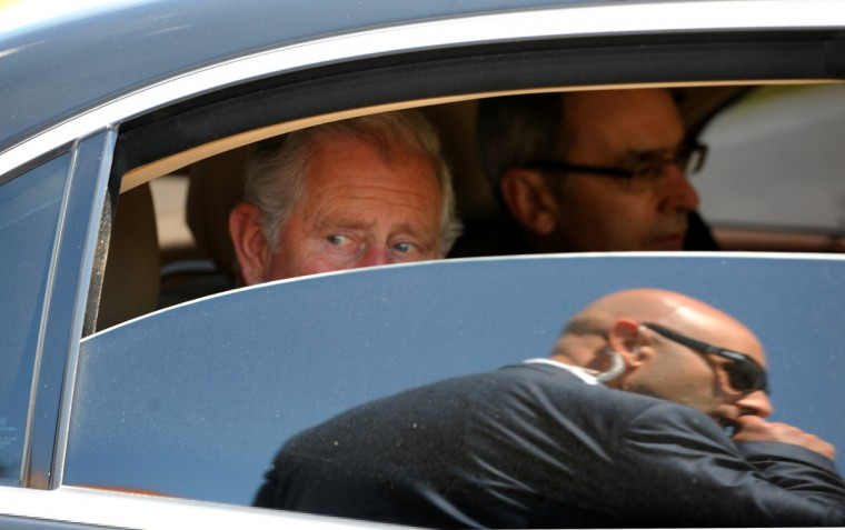 Britain's Prince Charles (L) looks from his limo as he visits the residence of the Armenian Apostolic Church leader, Catholicos Garegin II, in Etchmiadzin, outside Yerevan. Prince Charles is on a private visit to Armenia, the Armenian media reported. (Karen Minasyan/Getty images)