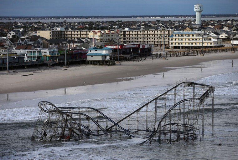 Waves break in front of a destroyed roller coaster wrecked by Superstorm Sandy on October 31, 2012 in Seaside Heights, New Jersey. (Mario Tama/Getty Images)
