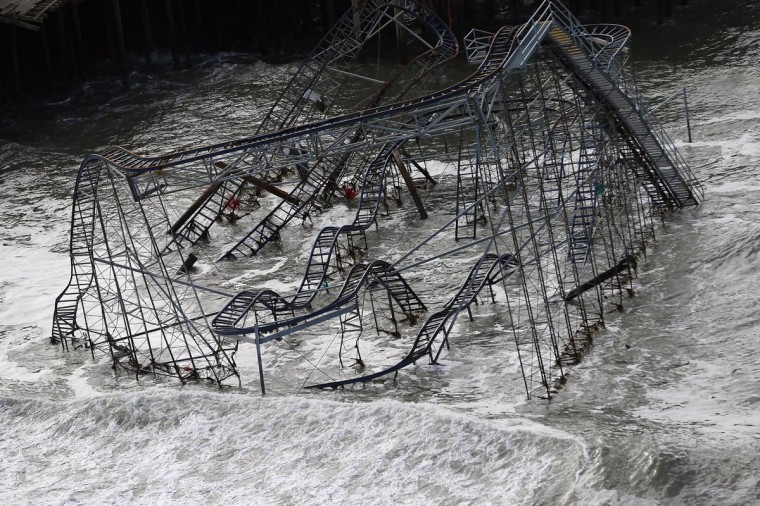 Surf rolls past a destroyed roller coaster wrecked by Superstorm Sandy on October 31, 2012 in Seaside Heights, New Jersey. (Mario Tama/Getty Images)