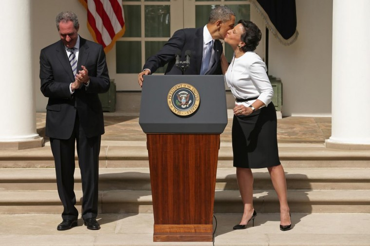 U.S. President Barack Obama kisses nominee for Commerce Secretary, Chicago business executive Penny Pritzker, after wishing her a happy birthday, as his nominee for trade representative, economic adviser Mike Froman, looks on in the Rose Garden at the White House May 2, 2013 in Washington, DC. (Chip Somodevilla/Getty Images)