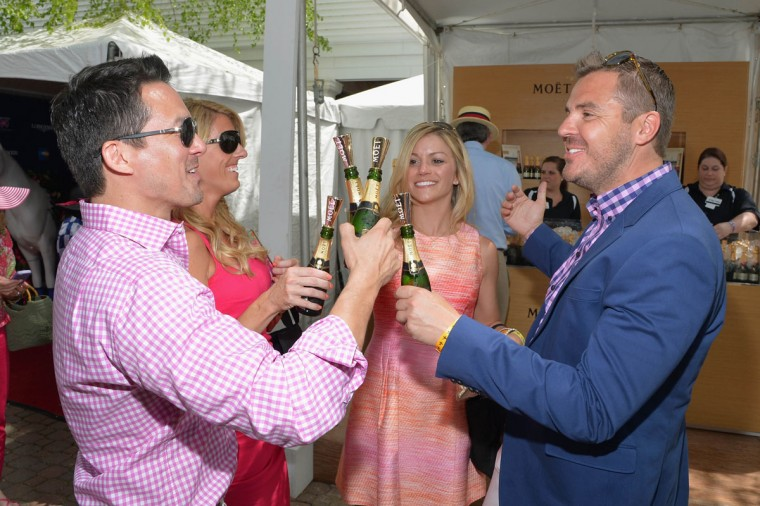 Guests celebrate Kentucky Oaks Day with Moet & Chandon at Churchill Downs on May 3, 2013 in Louisville, Kentucky. (Mike Coppola/Getty Images for Moet & Chandon)