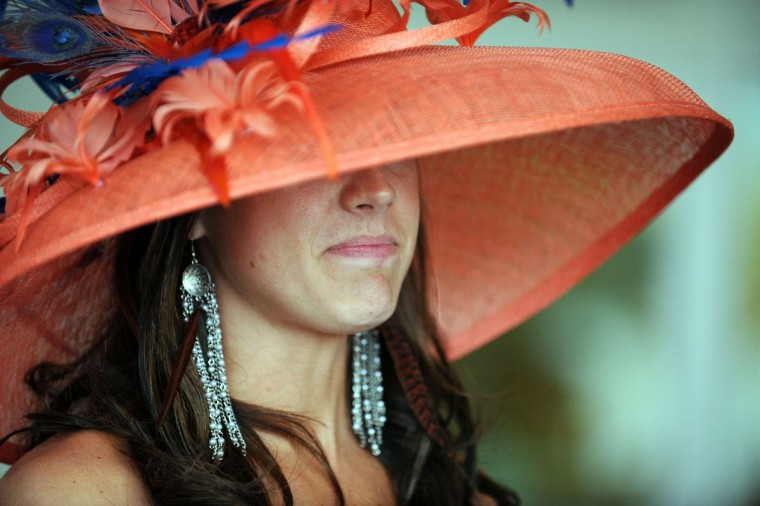 A race fan wearing a festive hat attends the 139th running of the Kentucky Derby at Churchill Downs on May 4, 2013 in Louisville, Kentucky. (Jamey Price/Getty Images)