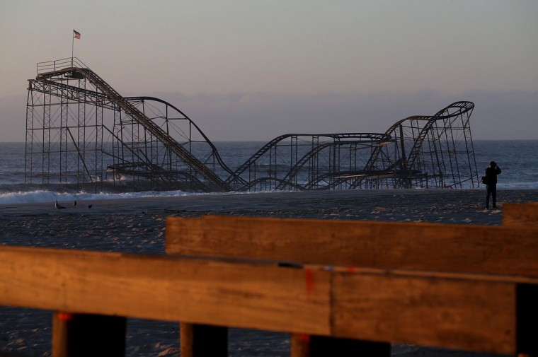 The Jet Star roller coaster remains in the ocean May 4, 2013 as work continues the new boardwalk that was damaged six months ago by Superstorm Sandy. (Mark Wilson/Getty Images)