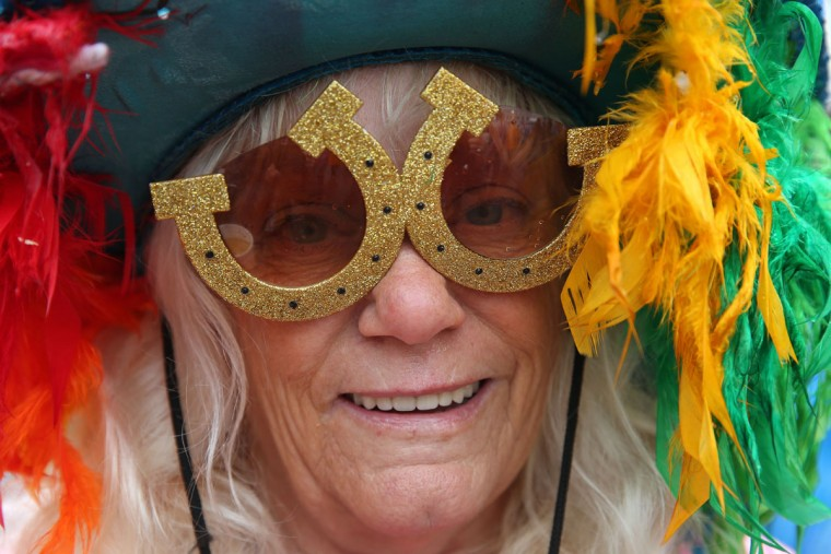 A race fan in a festive costume poses for a photo prior to the 139th running of the Kentucky Derby at Churchill Downs in Louisville, Kentucky. (Andy Lyons/Getty Images)