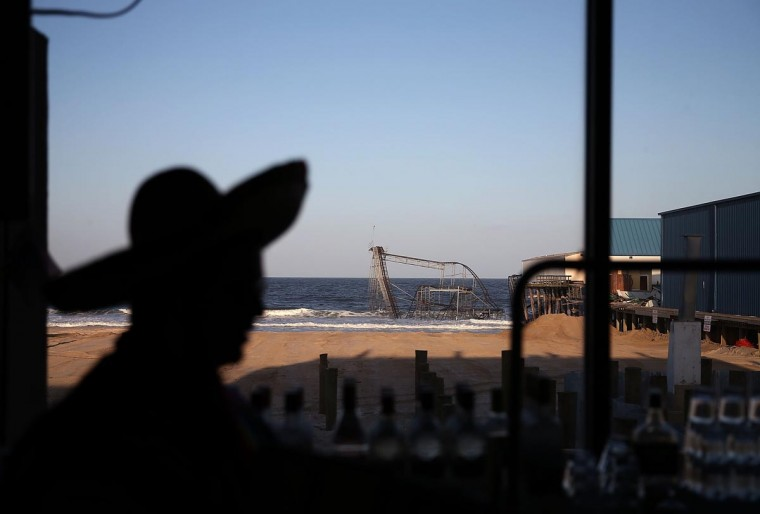 Bartender Mike Palazzo wears a sombrero at the Aztec bar located in front of the Jet Star roller coaster that still remains in the ocean after it was damaged six months ago by Superstorm Sandy. Photo taken May 4, 2013. (Mark Wilson/Getty Images)
