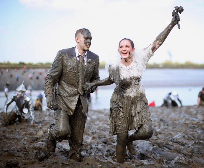 A couple dressed as a bride and groom take part in the Maldon Mud Race on May 05, 2013 in Maldon, Essex. The race originated in 1973 and involves competitors racing around a course on the mudbanks of the river Blackwater at low tide. (Dan Kitwood/Getty Images)
