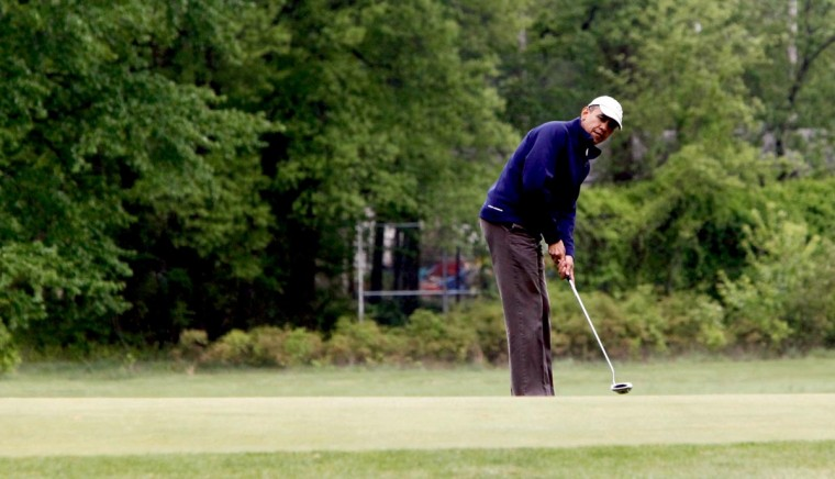 "U.S. President Barack Obama makes a shot as he plays golf with some Senators May 6, 2013 at Joint Base Andrews, Maryland. Obama played with U.S. Sen. Bob Corker (R-TN), and U.S. Sen. Saxby Chambliss (R-GA) and U.S. Sen. Mark Udall (D-CO) and planned to to discuss ""a range of issues"" with his Republican playing partners, seeking ""common ground."" (Dennis Brack-Pool/Getty Images)"