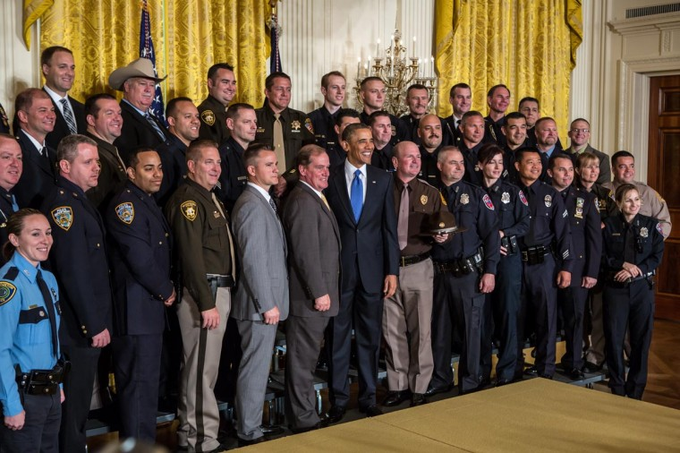 U.S. President Barack Obama poses for a picture with the 2013 National Association of Police Organizations TOP COPS award winners during a ceremony honoring them at the White House on May 11, 2013 in Washington, DC. TOP COPS awardees are nominated by their fellow officers for outstanding service above and beyond the call of duty. (Brendan Hoffman/Getty Images)