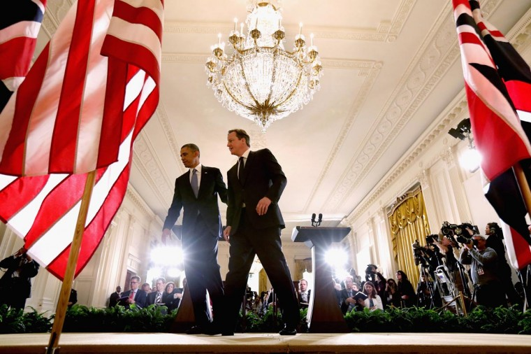 U.S. President Barack Obama (L) and British Prime Minister David Cameron leave the stage after holding a joint news conference in the East Room at the White House May 13, 2013 in Washington, DC. The two leaders discussed the prospect of an European Union-United States trade deal and the ongoing civil war in Syria. (Chip Somodevilla/Getty Images)