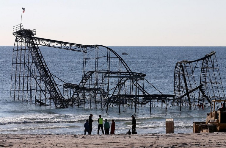 Workers prepare to remove the Jet Star roller coaster May 14 that has been in the ocean for six months after the Casino Pier it sat on collapsed when Superstorm Sandy hit. The Casino Pier has contracted Weeks Marine to remove the Jet Star roller coaster from the Atlantic Ocean. (Mark Wilson/Getty Images)