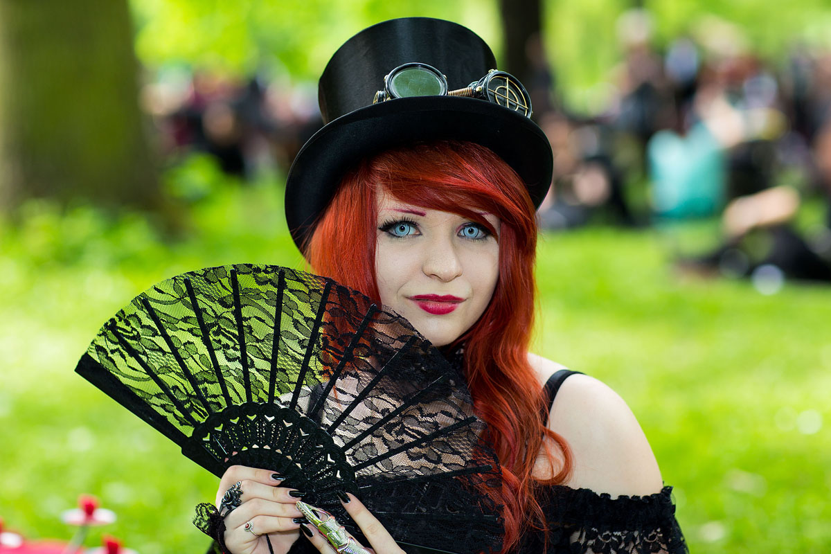 a girl with a fan attends the traditional park picnic