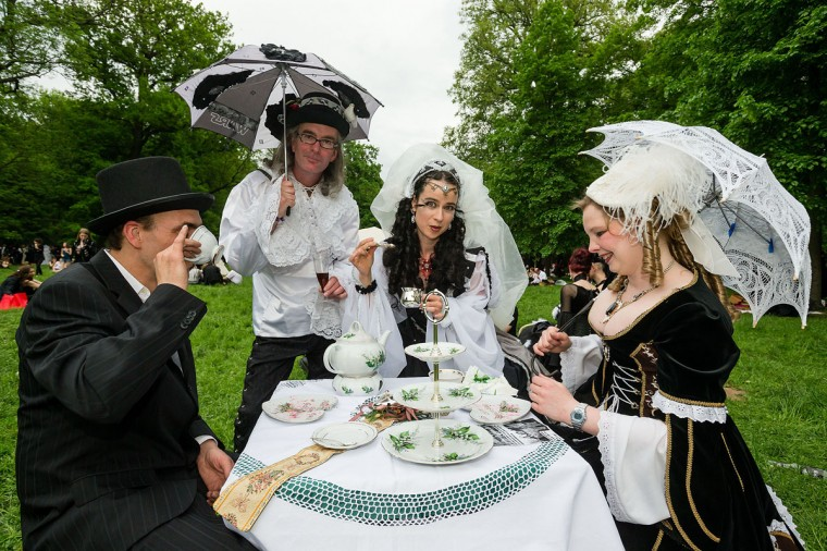 Participants have tea on a table on the lawn during the traditional park picnic on the first day of the annual Wave-Gotik Treffen, or Wave and Goth Festival, on May 17, 2013 in Leipzig, Germany. (Marco Prosch/Getty Images)
