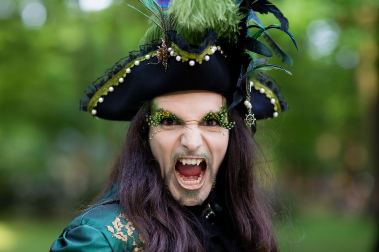 A man with fake vampire teeth wearing a pirate's costume attends the traditional park picnic on the first day of the annual Wave-Gotik Treffen, or Wave and Goth Festival, on May 17, 2013 in Leipzig, Germany. (Marco Prosch/Getty Images)