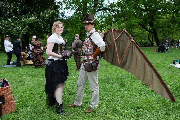 A man in a steam-punk outfit with self-made wings and a woman in Victorian clothing holding the book 'The Hobbit' attend the traditional park picnic on the first day of the annual Wave-Gotik Treffen, or Wave and Goth Festival, on May 17, 2013 in Leipzig, Germany. (Marco Prosch/Getty Images)